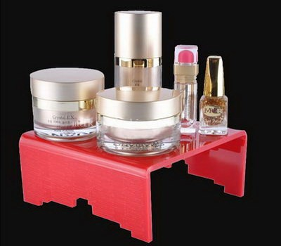 Red acrylic display riser for cosmetic